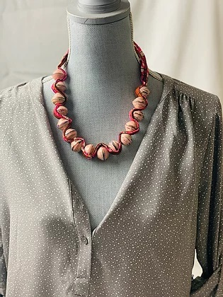 "Pink ""Sezibwa"" necklace on mannikin"
