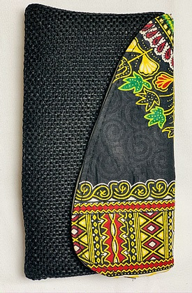full view of dark clutch with hand sewn embroidery