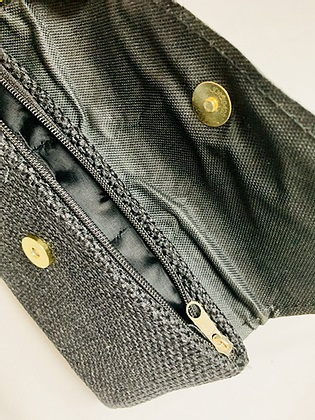 inside dark clutch with hand sewn embroidery