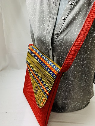 worn handmade red, medium cross body bag