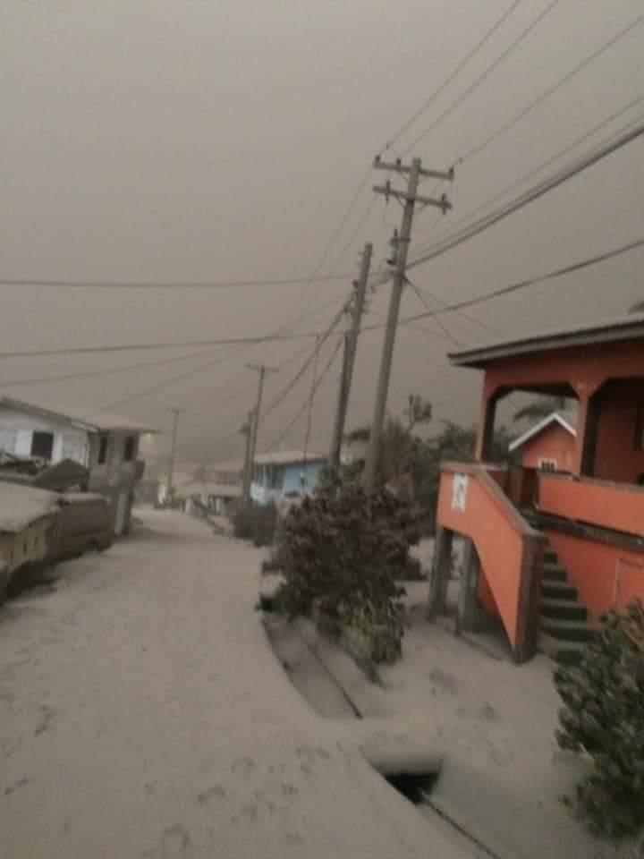Ash covering roads and yard with wo-story house