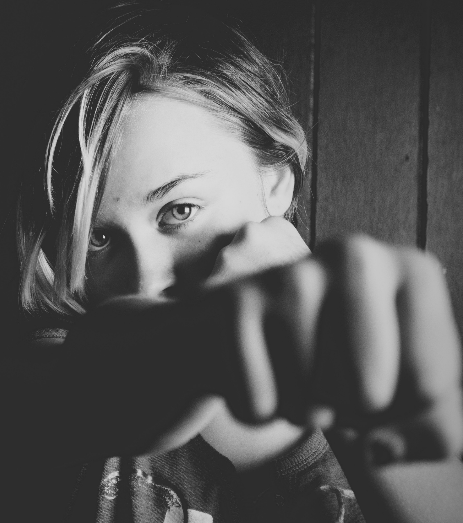 black and white photo of person punching